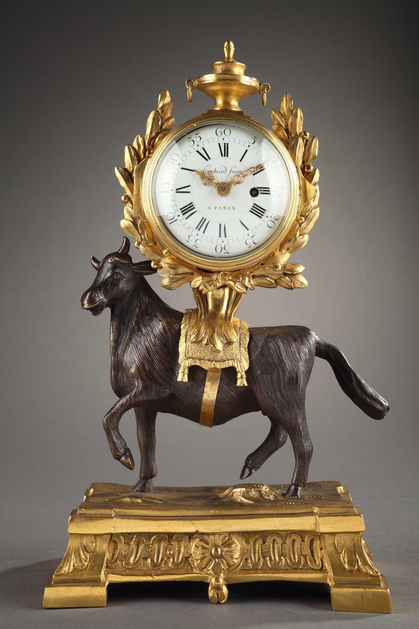 Pendule taureau - Epoque Louis XVI, en bronze doré et patiné